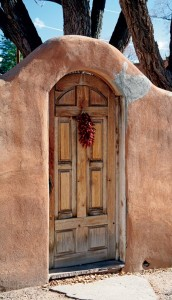 Entrance doors in adobe surrounds are a core Santa Fe Style tradition.
